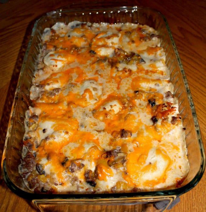 A full pierogi casserole in a baking dish.