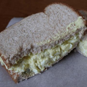 A sandwich on a piece of parchment paper.