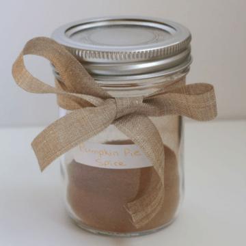 Pumpkin Pie Spice in a jar with a ribbon tied around it.
