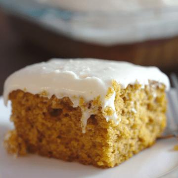 A slice of pumpkin cake on a plate.