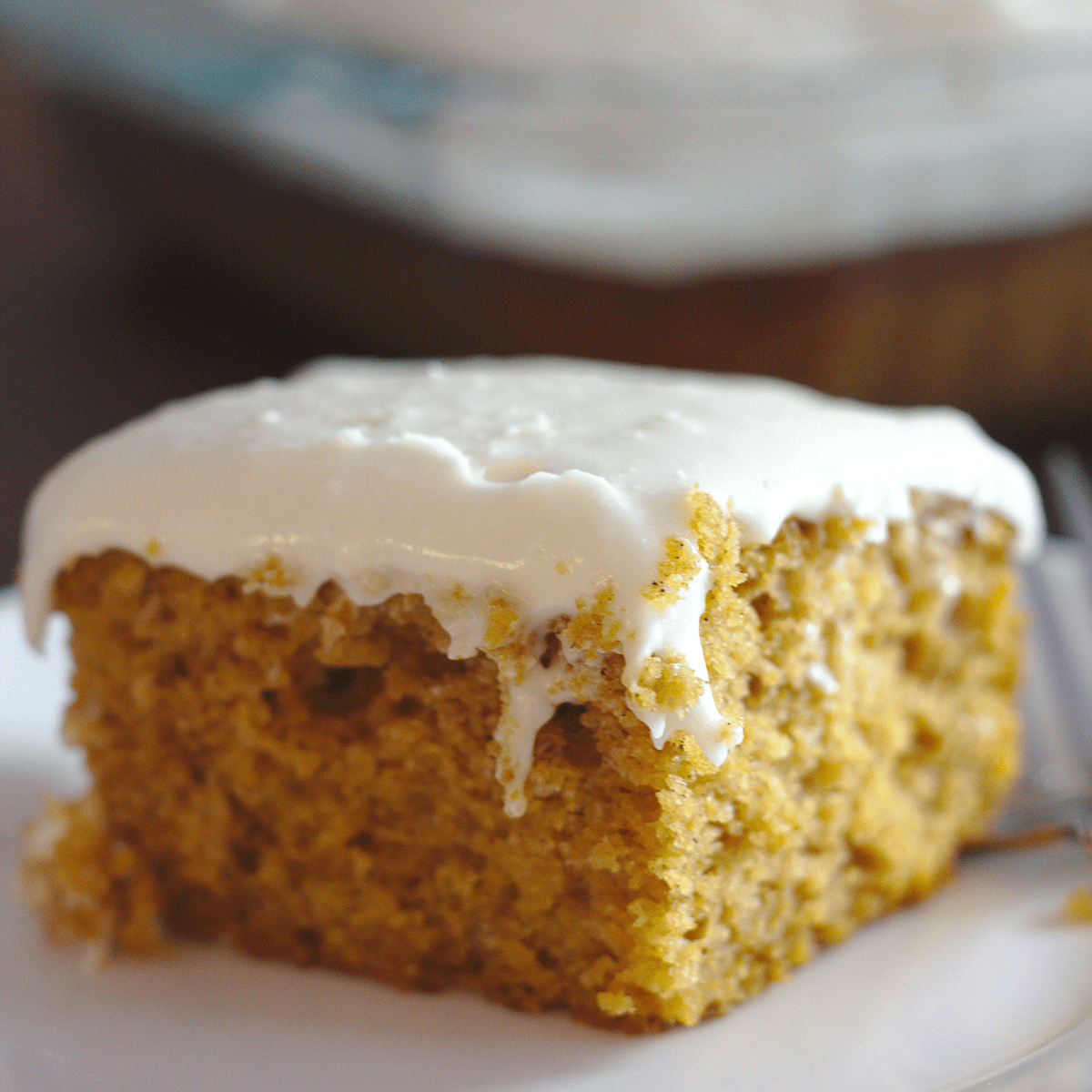 A slice of pumpkin cake on a plate.