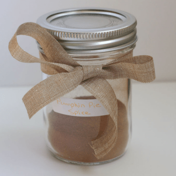 A jar of spice with a bow around it.