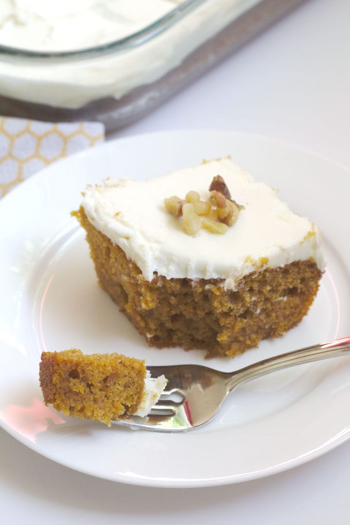 A piece of pumpkin cake on a plate.