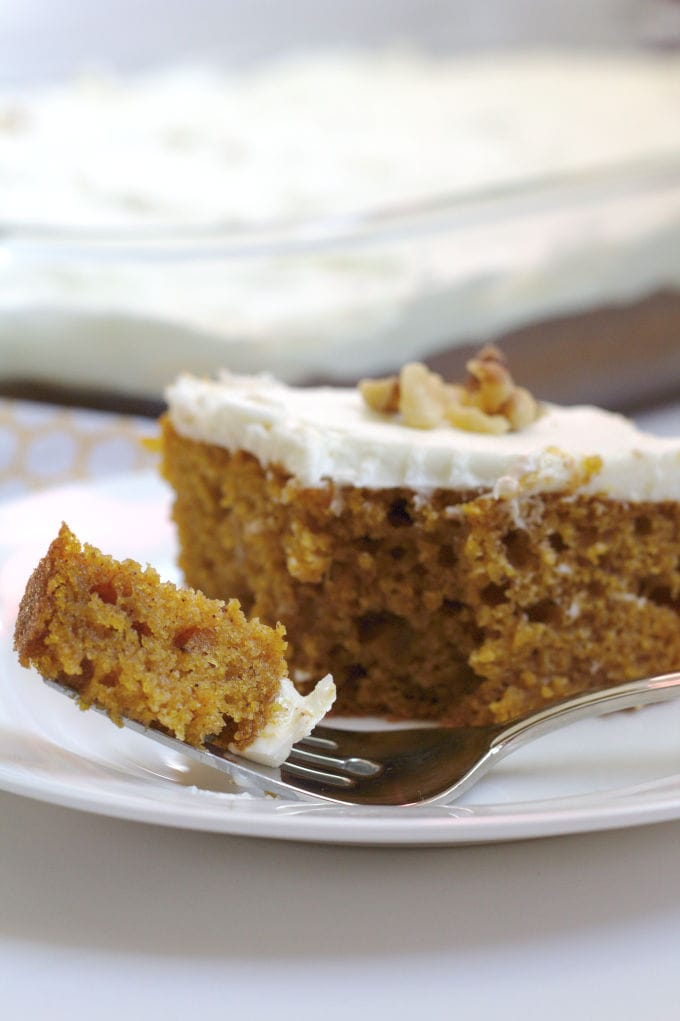 A closeup of a piece of pumpkin cake on a plate.