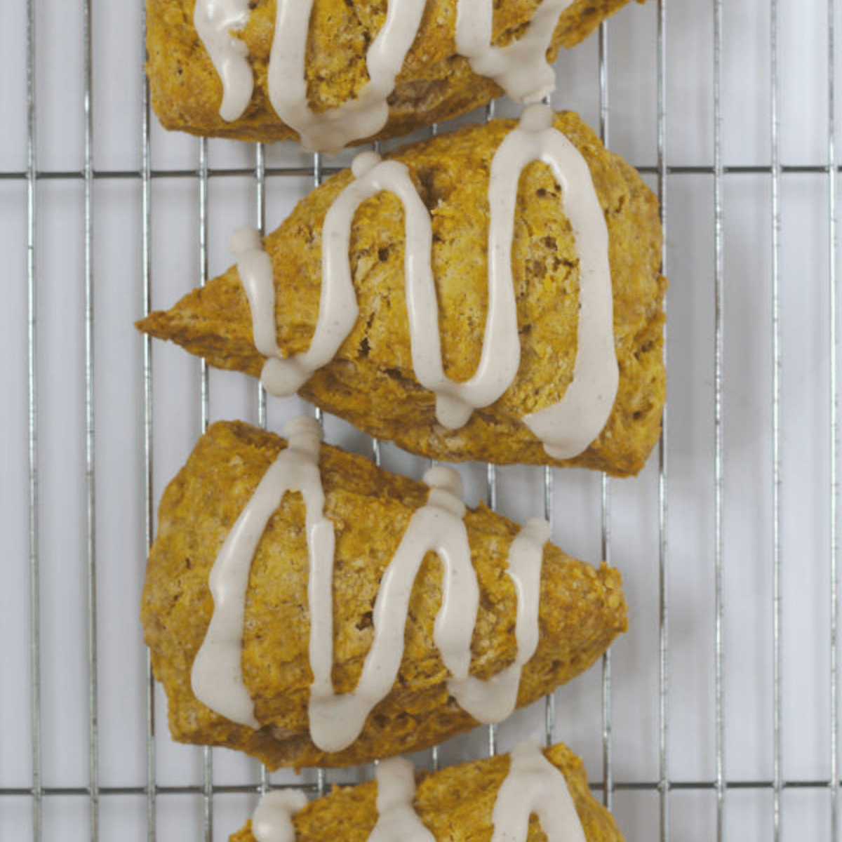 scones in a line on a cooling rack.