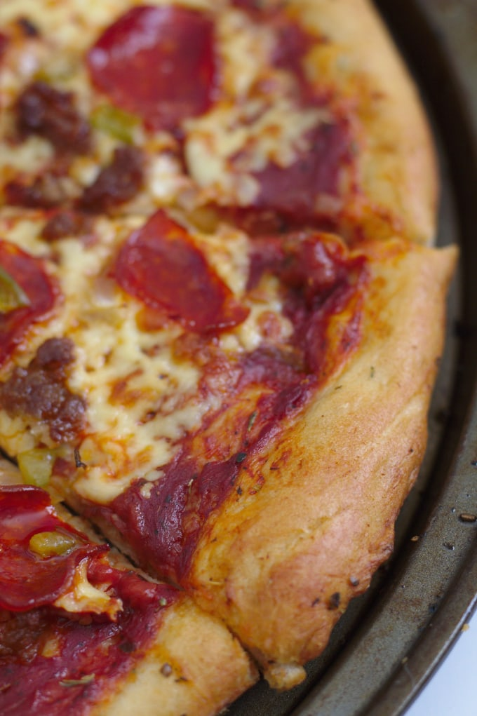A closeup of a homemade pizza.