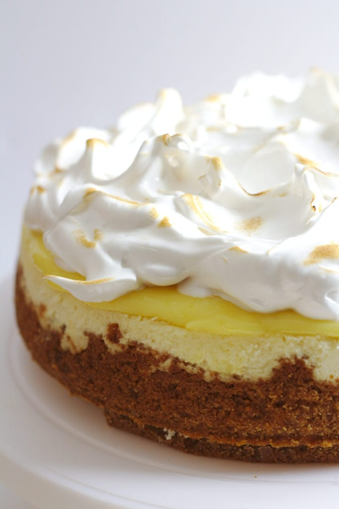 A half view of a cheesecake.