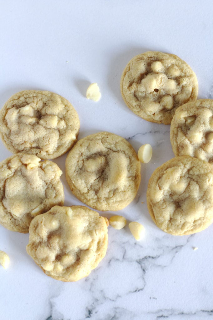Many cookies with white chocolate chips around them.