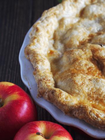 Apples around a pie.