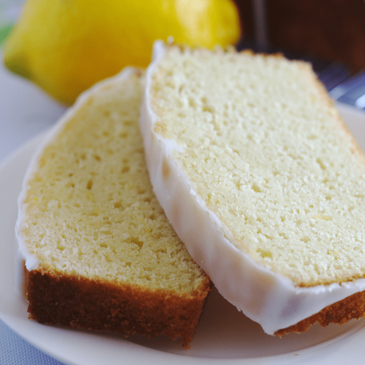 Two slices of lemon loaf on a plate.