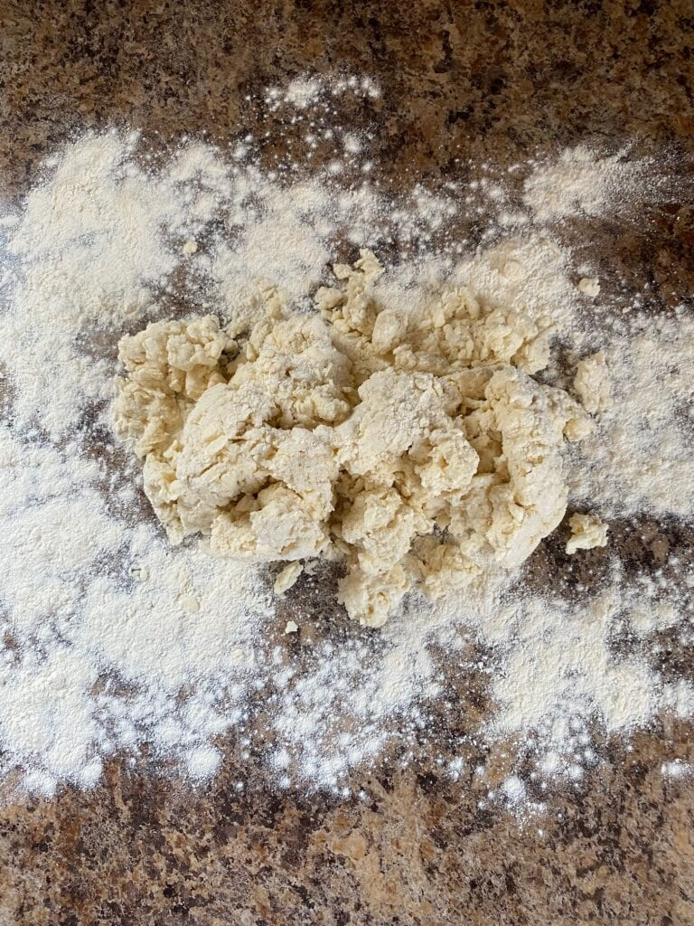 Biscuit dough on a floured work surface.