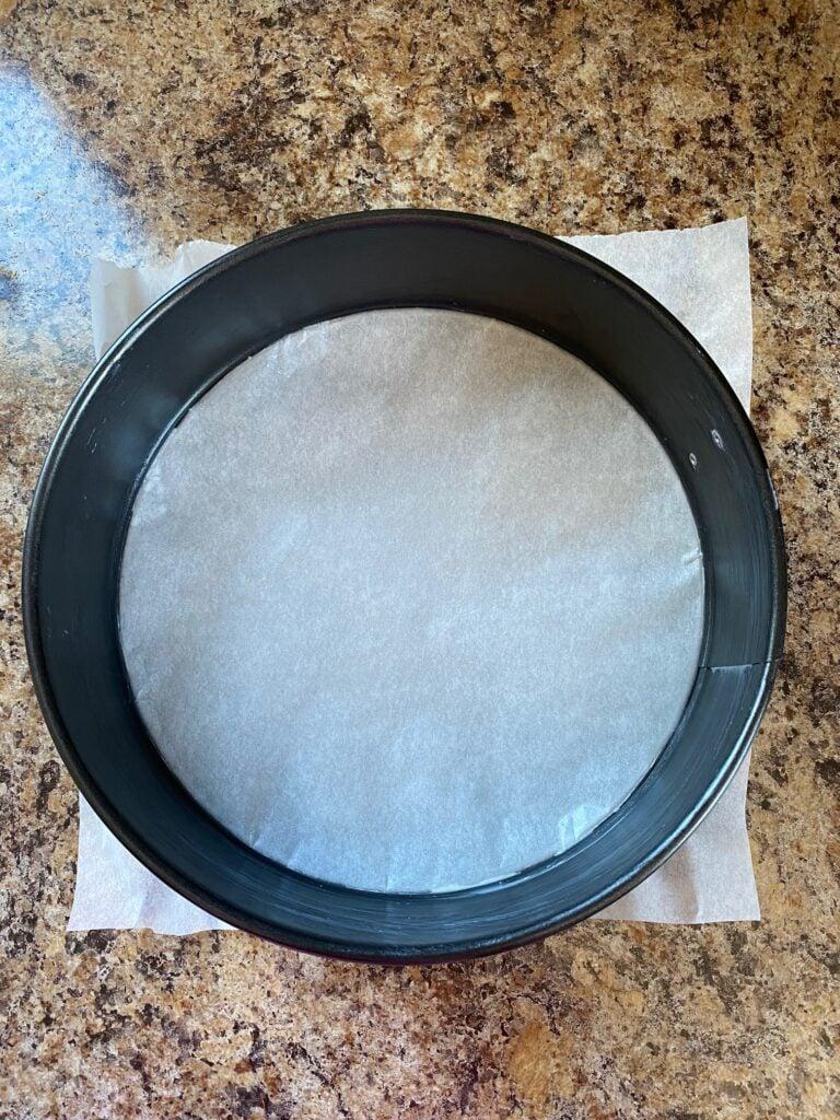 Parchment paper lining a springform pan.