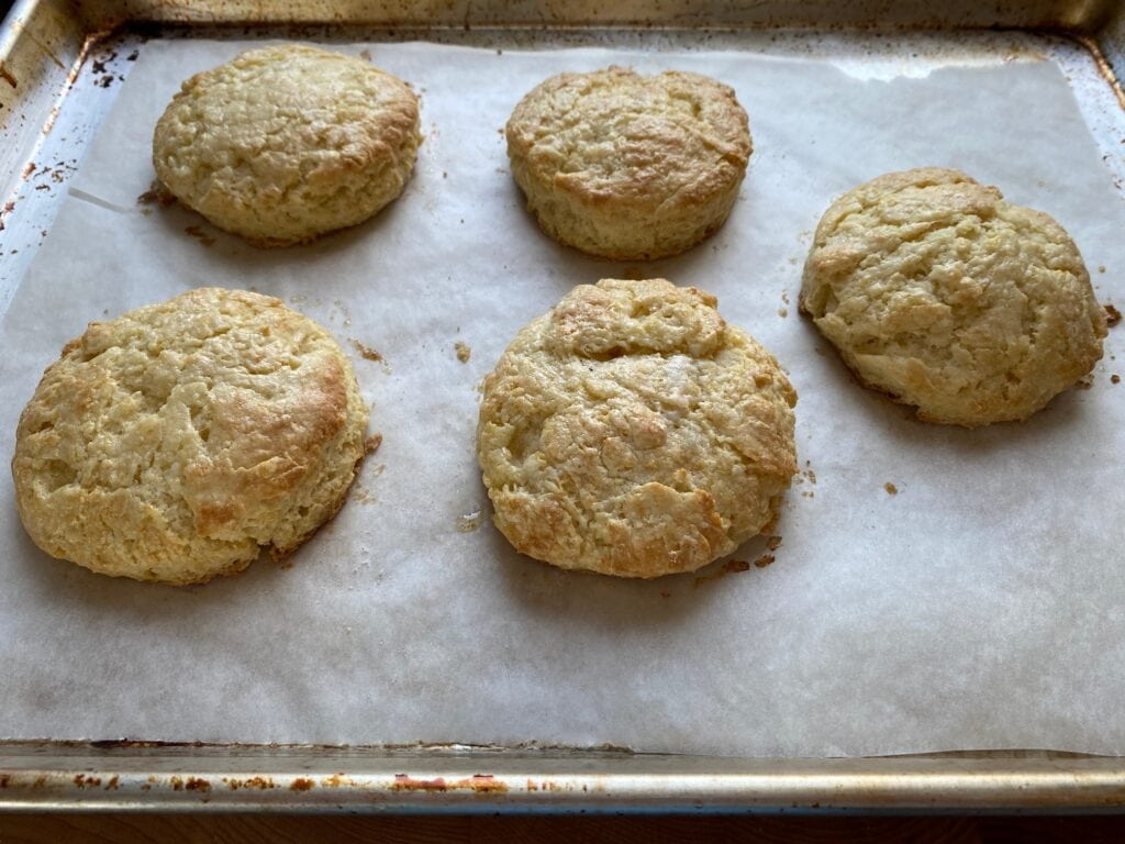 Cooked biscuits on a baking sheet.