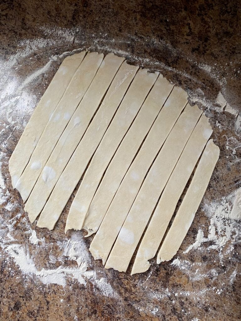 Strips cut from pastry for the lattice top.