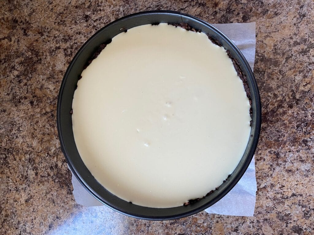 Cheesecake filling is in the springform pan.