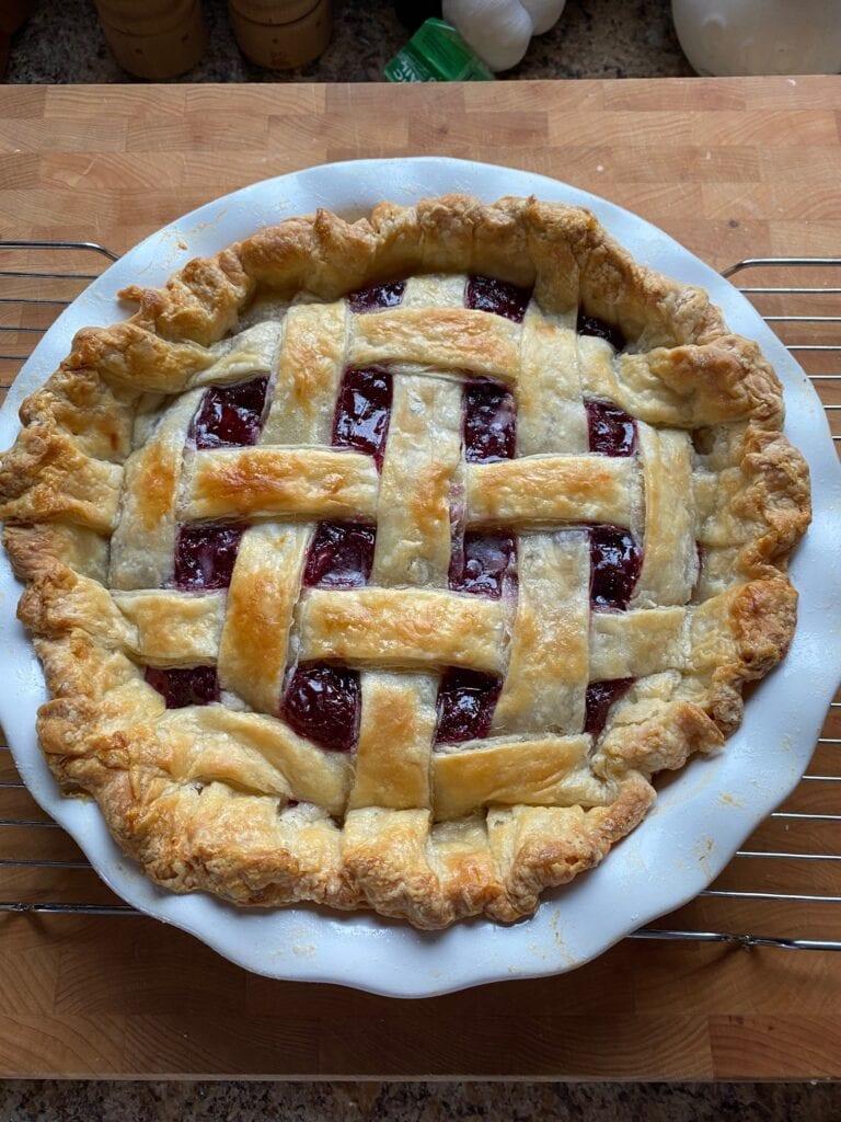 Baked pie in a white pie dish.