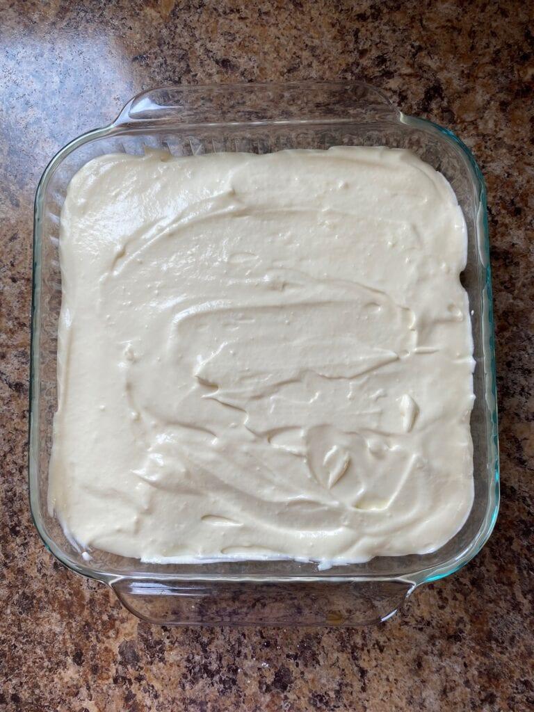 A final layer of Tiramisu filling in the baking dish.