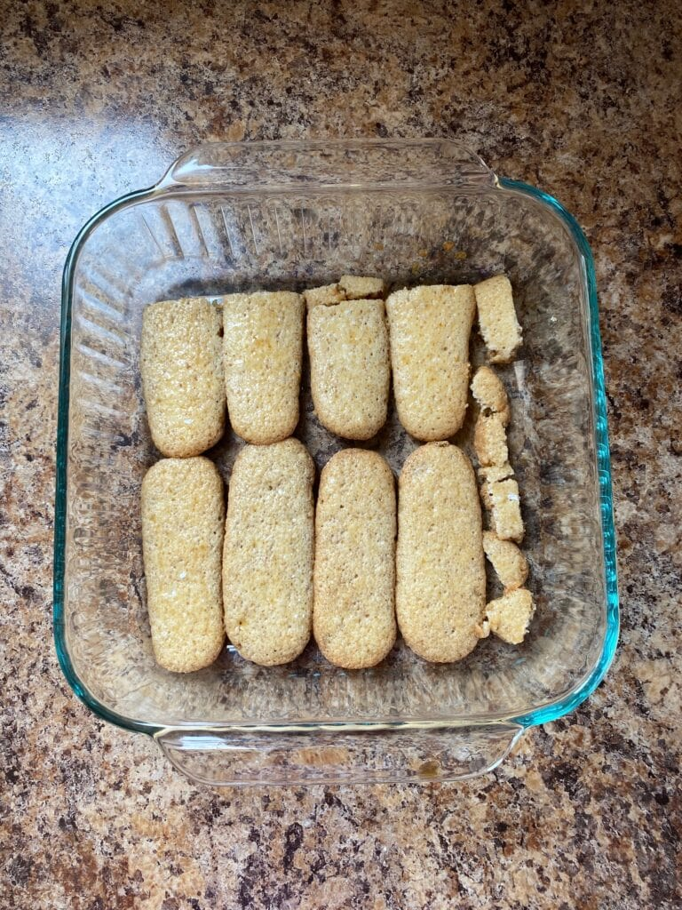 Ladyfingers in the bottom of a baking dish.