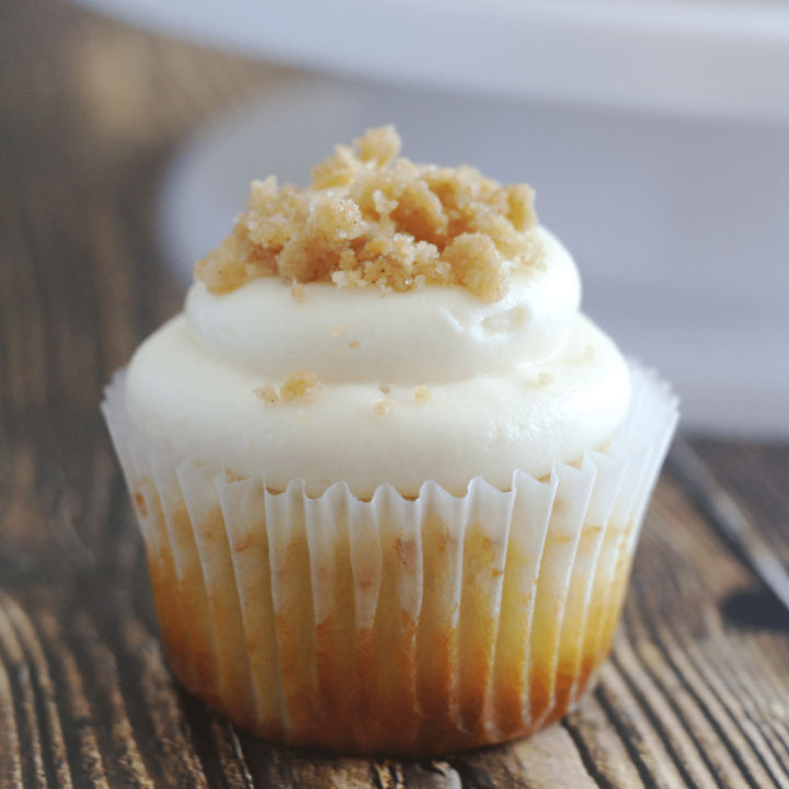A cupcake with crumble on top of the frosting.