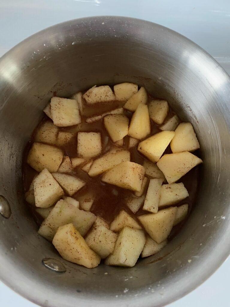 Apples, lemon juice, water, brown sugar, cinnamon, nutmeg and cornstarch combined in a small saucepan.