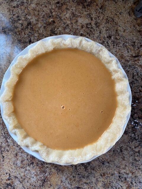 Pumpkin pie filling in par baked pie shell.