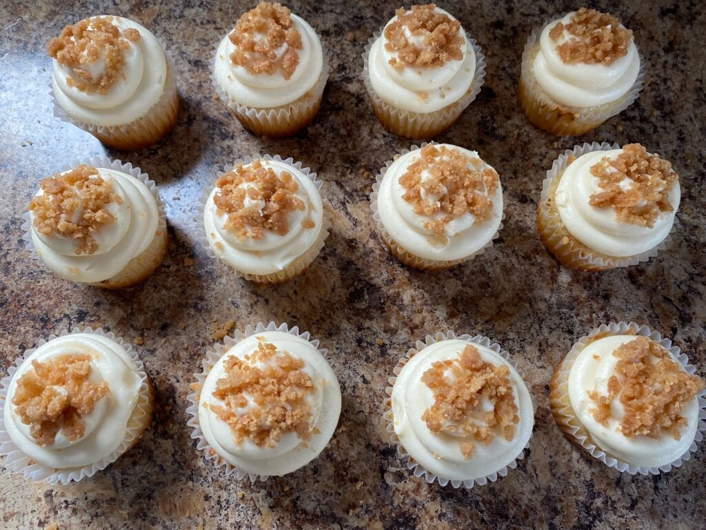 Frosted cupcakes with crumble on top.