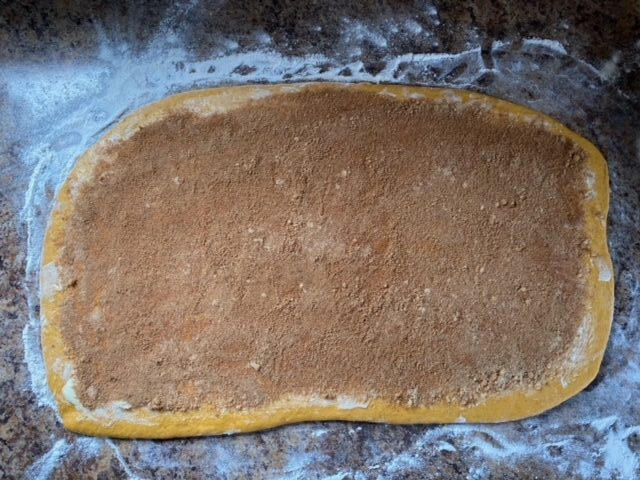 Brown sugar and spices on rolled out dough.